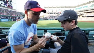 Helping a kid catch baseballs at Progressive Field