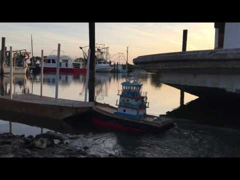 RC Tugboat pushing a spud barge
