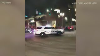 Video shows Tacoma police vehicle driving over at least one person on a crowded street