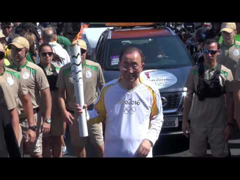 Ban Ki-moon carries the Olympic torch at Rio 2016