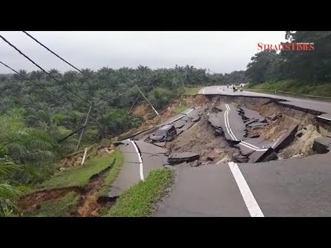 Car occupants cheat death as road collapses in Mersing