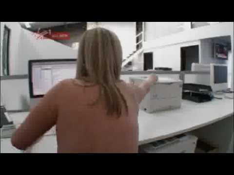 Nudist milf in an office