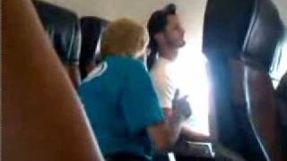 CRAZY OLD LADY FREAKS OUT ON A PLANE