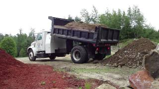 International 4700 Dumping a load of fill