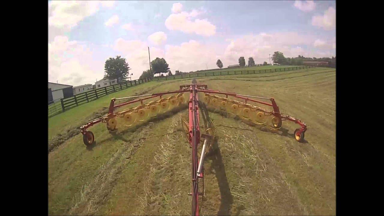 New Holland HT154 14 wheel v-rake in action by Farmerjon9660