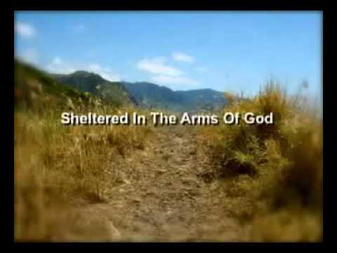Sheltered In The Arms Of God