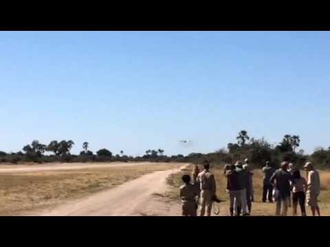 Botswana Air Force C130 landing at an airstrip in the Okavango Swamps