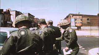 A soldier and an official inspect and talk after the Baltimore Riots in Baltimore...HD Stock Footage