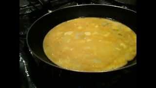 Faire une omelette au fromage / Préparer une omelette avec de la vache qui rit
