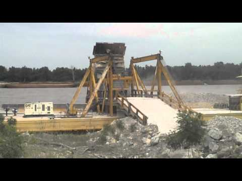 777 Cat dumping aggregate on a barge