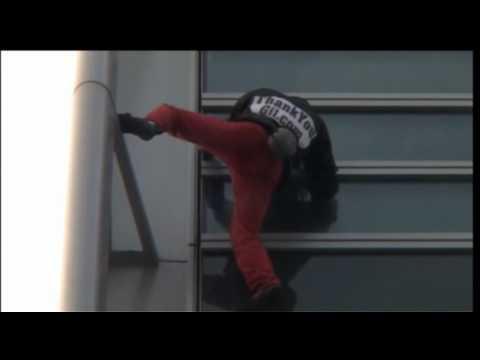 Spiderman climb T1 Tower in Paris