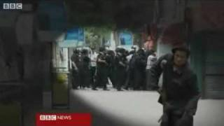 Chinese forces hit defenseless Uyghur protesters in Xinjiang July 10, 2009