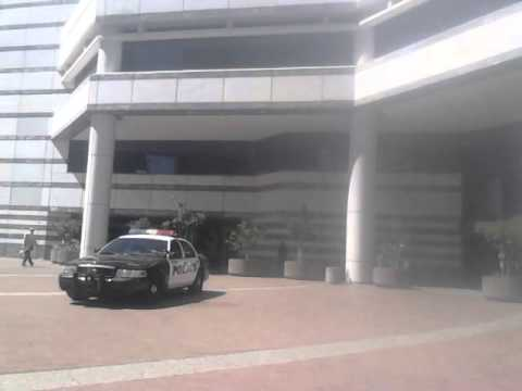 Tucson Police Officer parks in plaza in front of library for over an hour (video1)