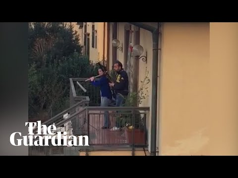 Coronavirus: neighbours play instruments from balconies as Italy stays under lockdown