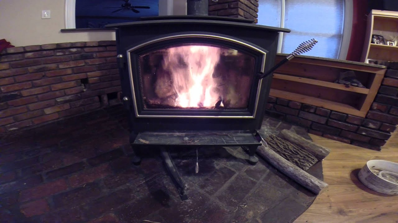 Best way to clean wood stove glass and start a fire in a Quadra-fire WoodStove - YouTube