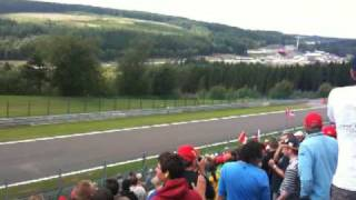 Kimi Räikkönen overtaking Giancarlo Fisichella at Spa Francorchamps 2009
