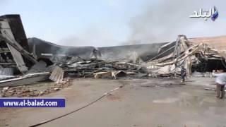 بالفيديو والصور.. الحماية المدنية بسوهاج تواصل إطفاء النيران لليوم الثاني بمصنع الهلال والنجمة
