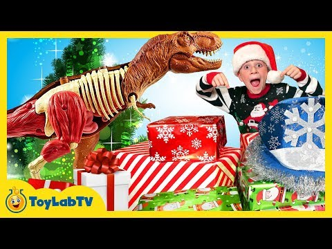 Christmas for the Dinosaurs! Opening Dinosaur Presents from Santa & Jurassic World Surprise Toys