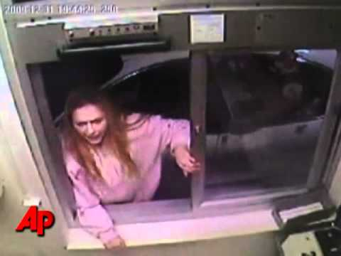 Video  Caught On Surveillance Cam  Crazy Lady From Ohio Tries To Beat Down A McDonald's Drive Thru Worker For Refusing To Sell Her McNuggets!