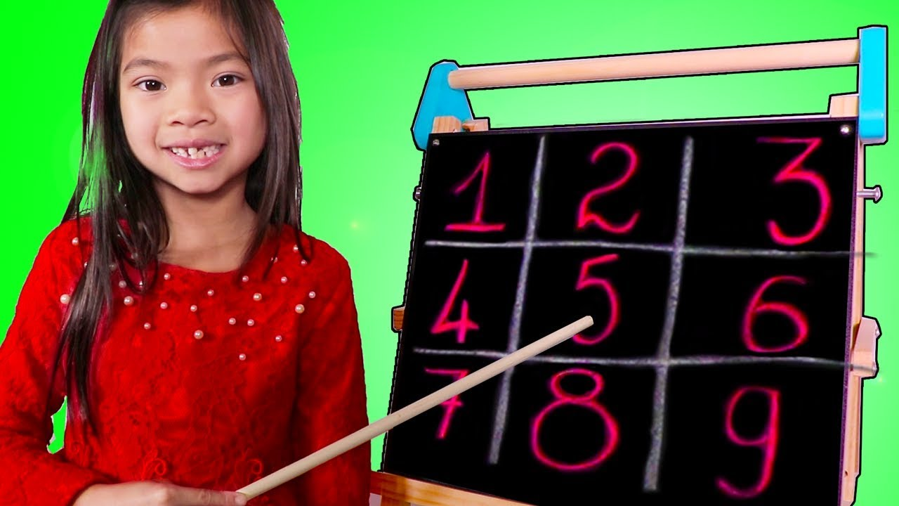 Emma Pretend Play as a Math Teacher