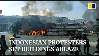 Indonesian protesters set a government building on fire as civil unrest continues