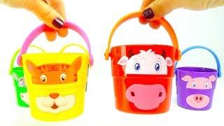 Сюрпризы и игрушки в забавных, разноцветных ведерках