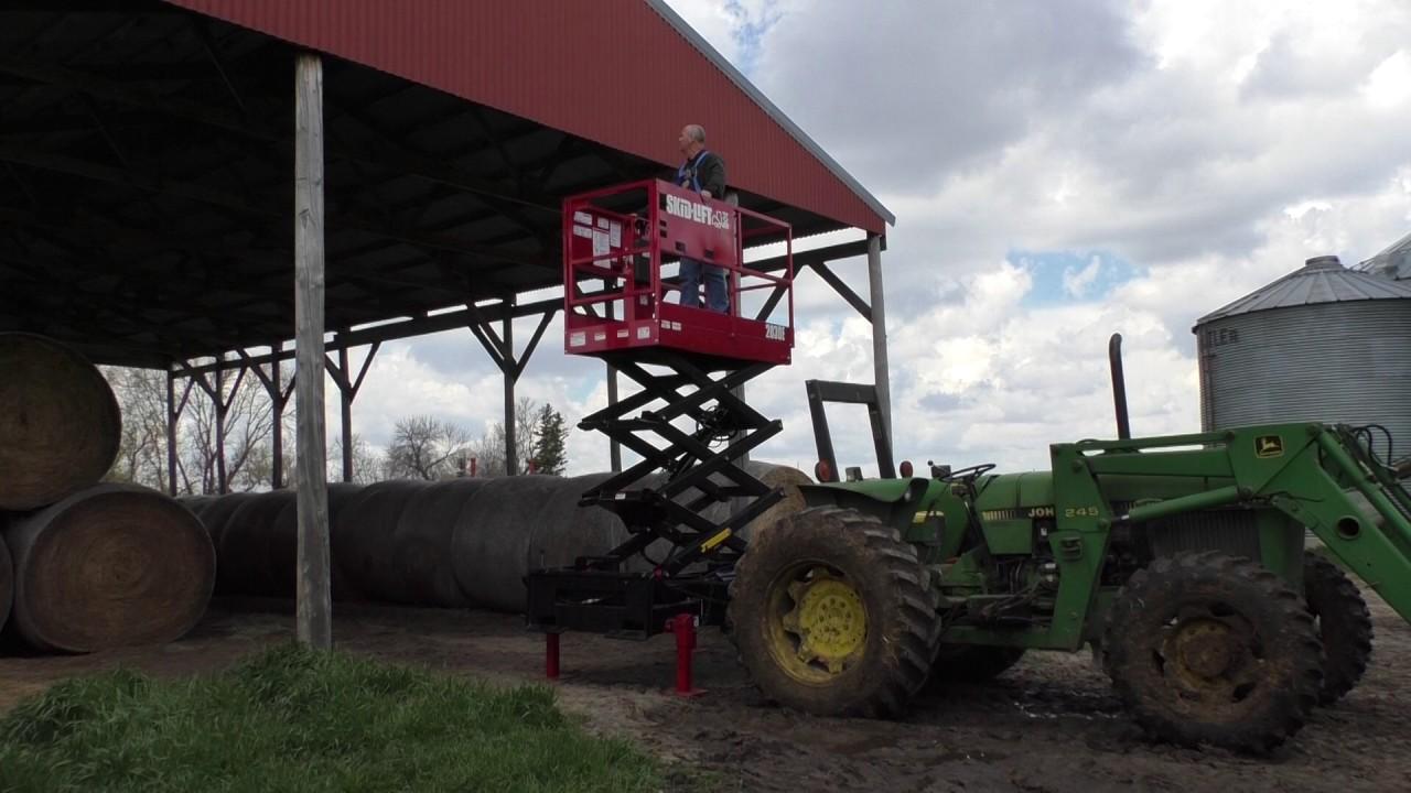 Tractor 3 Pt Lift : Skid lift scissor working with a john deere farm