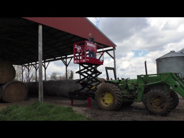 Skid-Lift Scissor Lift working with a John Deere Farm Tractor