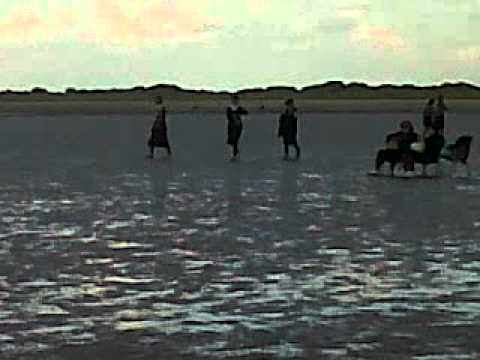 Hasidic Jews walking into the ocean on Ainsdale Beach