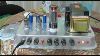 DIY Tube Amplifier  using schematics from ax84.  12ax7 for pre amp  and el34 for power.