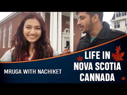 Mruga with Nachiket, explaining her life in Canada .