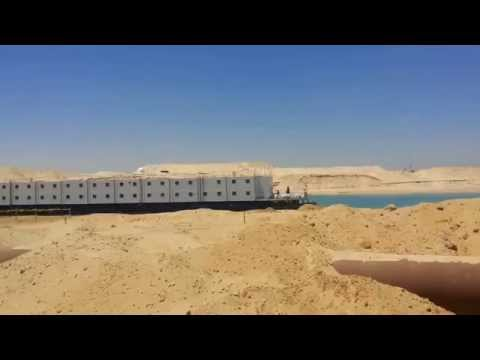 New Suez Canal: See expulsion pipes for dredgers hotel next to workers