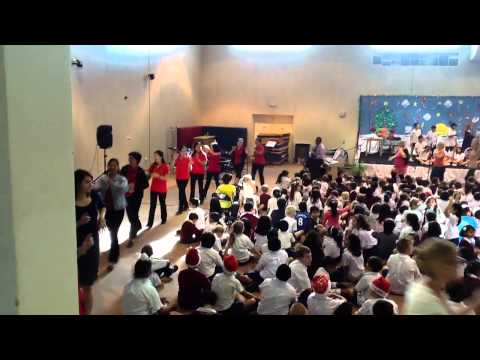 End of Term 1 Primary Assembly - Teachers & TAs Dancing
