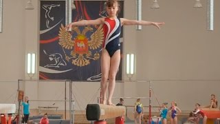 girl athlete  performance gymnastics balance beam at competitions in Russia