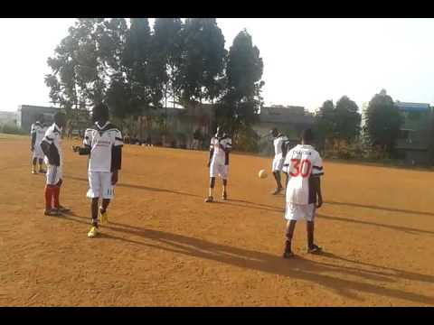 Party Pipo warming up for the friendly match with Fans at Kamwokya football grounds.Kampala Uganda.
