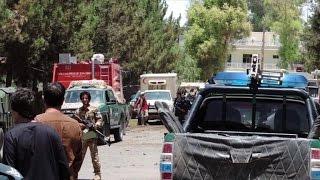Taliban car bombing at Afghan bank kills dozens