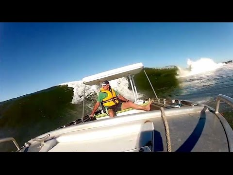 Pop Surfs Waves in Small Boat