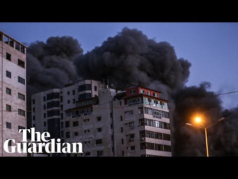 Israeli airstrike collapses tower block and Hamas rocket hits bus as violence escalates