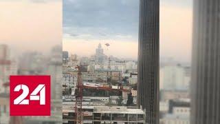 Экстремал совершил прыжок с парашютом со столичной высотки - Россия 24