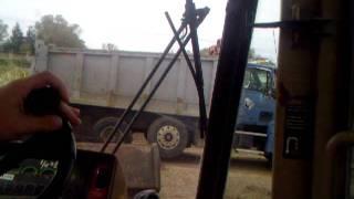 Deere 644G Loading A Dump Truck