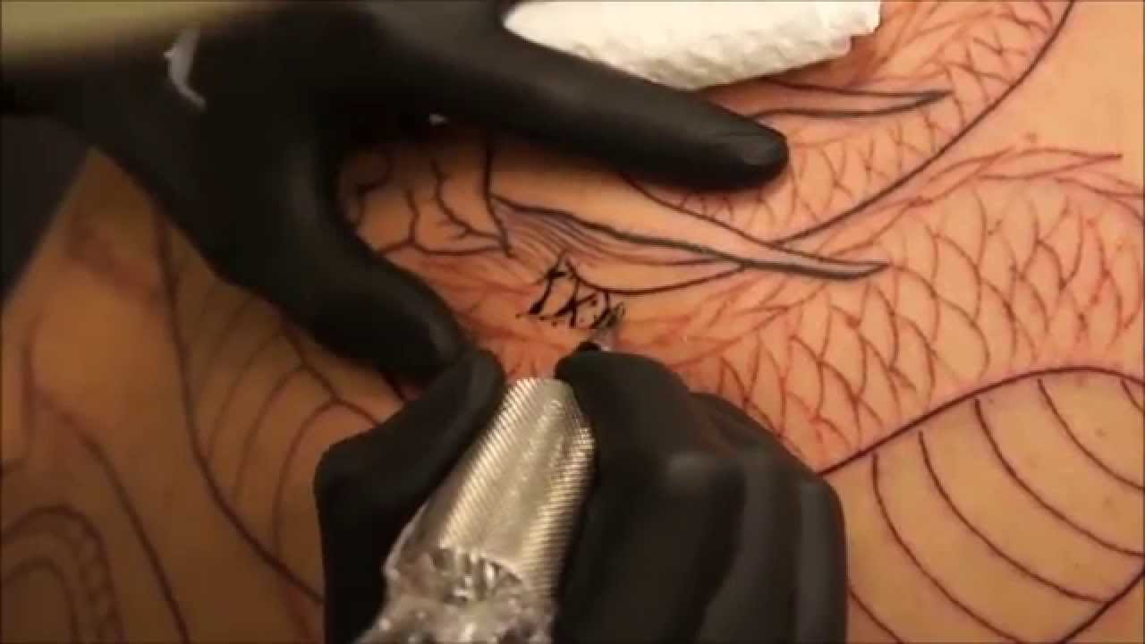 Black and grey dragon tattoo by ball at bkk ink tattoo for Eight ball tattoo removal