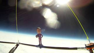 high altitude weather balloon launch bobblehead in space raises awareness of the needs of seniors