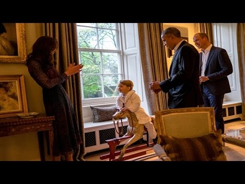 Prince George greets Obamas in his bedtime robe