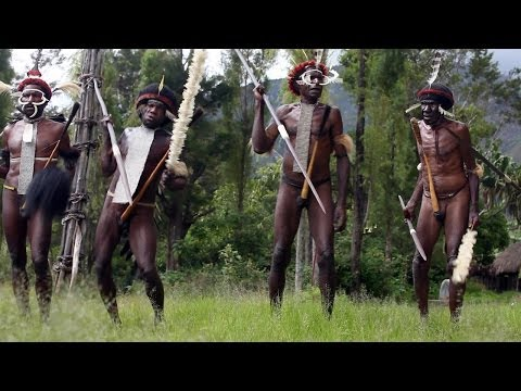 Dani warriors dancing in Baliem Valley - Papua province, island of New Guinea