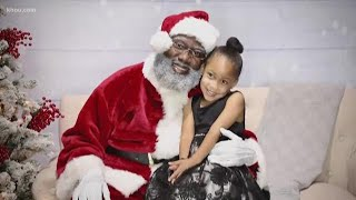 Photo sessions with Black Santa sell out fast