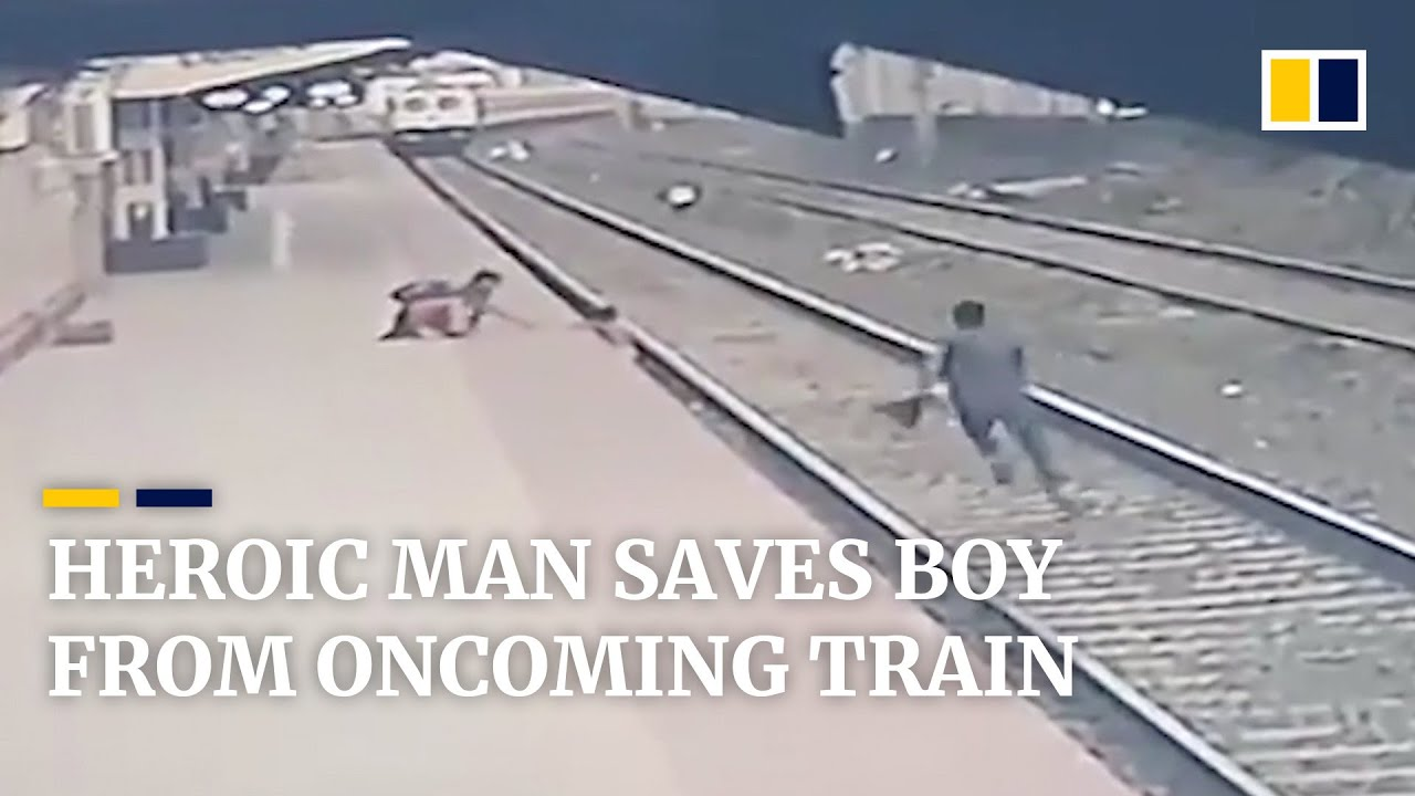 Heroic man saves young boy from oncoming train in India