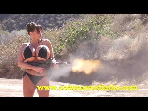 Big Boob Girl in a Bikini Shooting  Machine Gun