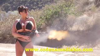 Big Boob Girl in a Bikini Shooting  Machine Gun thumbnail