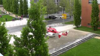 BK 117 rescue helicopter take off between buildings