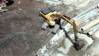 Cat 345DL Excavator digging underwater